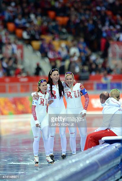 Russia's Olga Graf Russia's Ekaterina Lobysheva and Russia's Yuliya Skokova celebrate after winning the bronze medal in the Women's Speed Skating...