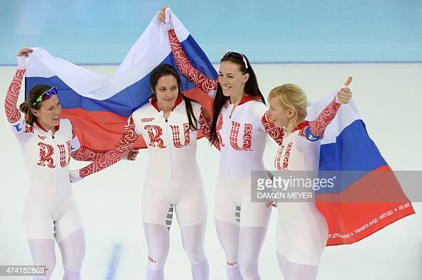 Russia's Olga Graf Russia's Ekaterina Shikhova Russia's Ekaterina Lobysheva and Russia's Yuliya Skokova celebrate after the Women's Speed Skating...