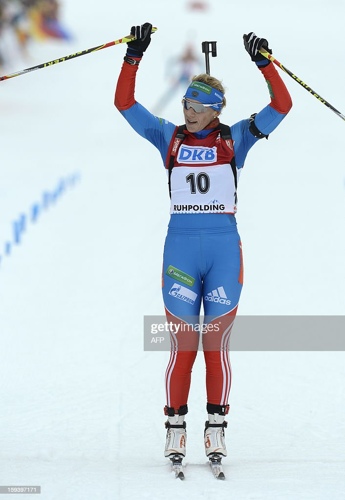 Russia's Olga Zaitseva celebrates as she arrives at the finish after the 12,5 km women Biathlon World Cup mass start competition on January 13, 2013, in Ruhpolding, southern Germany.Norway's Tora Berger won the competition, Belarus Darya Domracheva placed second and Russia's Olga Zaitseva placed third.