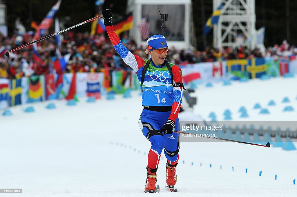 Russia's Olga Zaitseva crosses the finish line in the women's Biathlon 4x6 km relay at the Whistler Olympic Park during the Vancouver Winter Olympics on February 23, 2010. The Russian team claimed the women's biathlon relay gold.