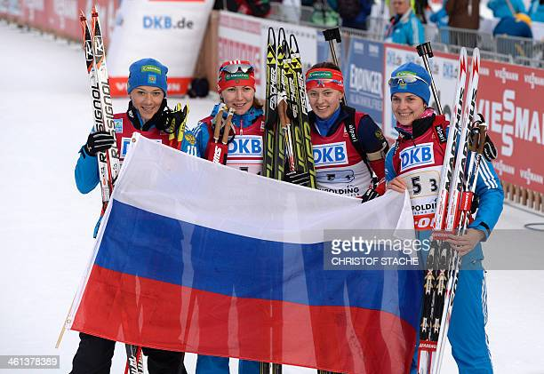 Russia's Olga Zaitseva Ekaterina Glazyrina Olga Vilukhina and Irina Starykh pose after the women's 4x6 km relay at the Biathlon World Cup on January...