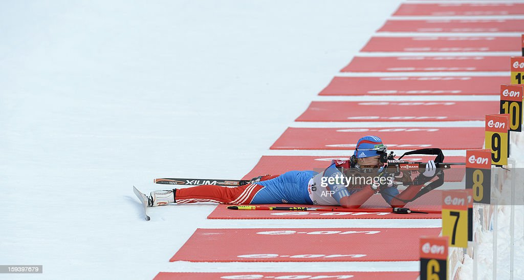 Russia's Olga Zaitseva shoots during a test shooting ahead of the 12,5 km women Biathlon World Cup mass start competition on January 13, 2013, in Ruhpolding, southern Germany. Tora Berger won the competition, Belarus Darya Domracheva placed second and Russia's Olga Zaitseva placed third. AFP PHOTO/CHRISTOF STACHE