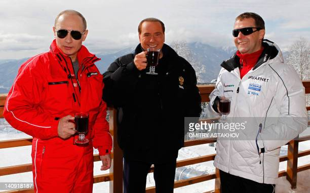 Russia's outgoing President Dmitry Medvedev and newly elected president Vladimir Putin meet with former Italy's Prime minister Silvio Berlusconi at...