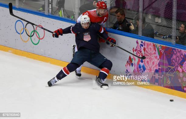 Russia's Pavel Datsyuk and USA's Ryan McDonagh in their Preliminary Round match during the 2014 Sochi Olympic Games in Krasnaya Polyana Russia