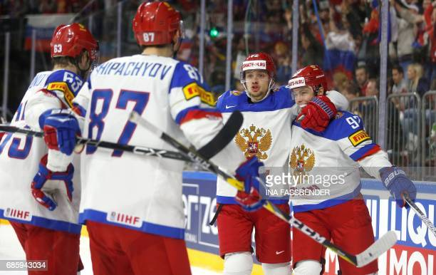 Russia's players celebrate a goal during the IIHF Men's World Championship Ice Hockey semifinal match between Canada and Russia in Cologne western...