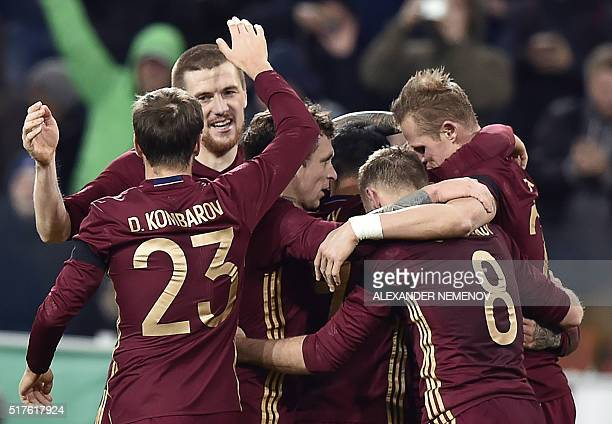 Russia's players celebrate a goal during their friendly football match between Russia and Lithuania at Otkrytie Arena in Moscow on March 26 2016 /...