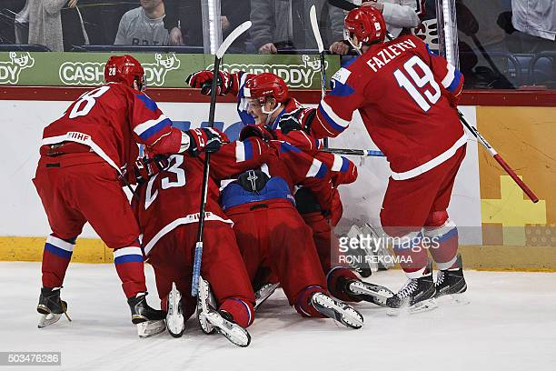 Russia's players celebrate Andrei Svetlakov's 33 goal which was made 8 seconds before the end of the normal play time during the 2016 IIHF World...