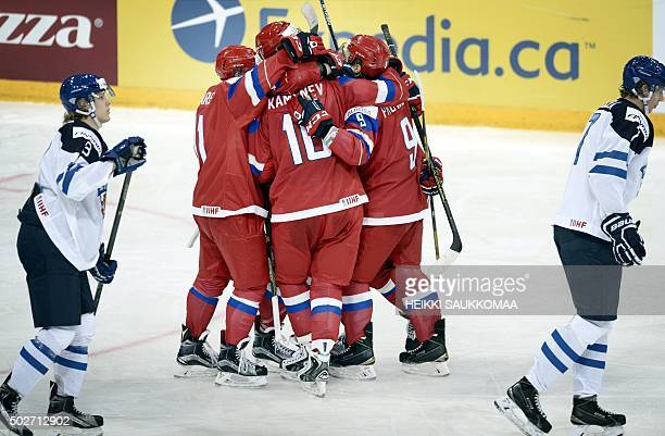 Russia's players Maxim Lazarev Vladislav Kamenev and Ivan Provorov celebrate the 43 goal by Kamenev during the 2016 IIHF World Junior Ice Hockey...