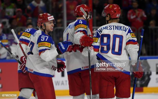 Russia´s players react after scoring during IIHF Ice hockey world championship first round match between Russia and Italy in the LANXESS arena in...
