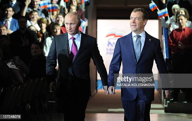 Russia's President Dmitry Medvedev and Prime Minister Vladimir Putin make a joint appearance at the congress of Russia's ruling party in Moscow on...