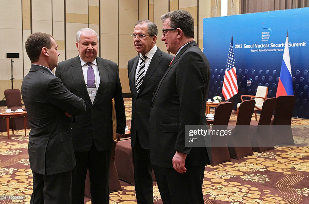 Russia's President Dmitry Medvedev (L) confers with (R-L) his foreign policy aide Sergei Prikhodko, Foreign Minister Sergei Lavrov and Russian Ambassador to the US Sergey Kislyak in Seoul on March 26, 2012, shortly after a bilateral meeting with US President Barack Obama on the sidelines of the 2012 Seoul Nuclear Security Summit. The two presidents and dozens of other world leaders were to begin the 2012 Seoul Nuclear Security Summit on March 26 curbing the threat of nuclear terrorism, but North Korea's atomic plans will be in focus on the sidelines.