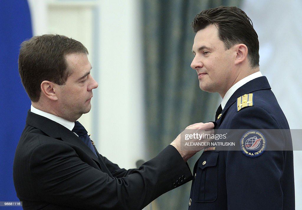 Russia's President Dmitry Medvedev (L) decorates Roman Romanenko, a Russian cosmonaut, with the order Hero of Russia during an award ceremony in Moscow's Kremlin on May 6, 2010.