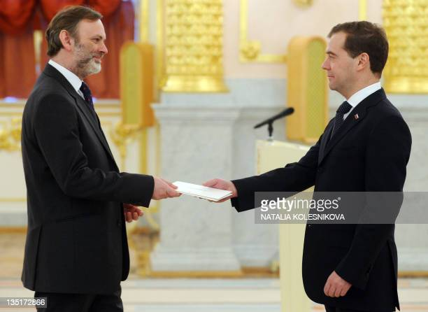 Russia's President Dmitry Medvedev speaks with Britain's Ambassador to Russia Tim Barrow at Aleksandrovsky hall in the Kremlin in Moscow on December...