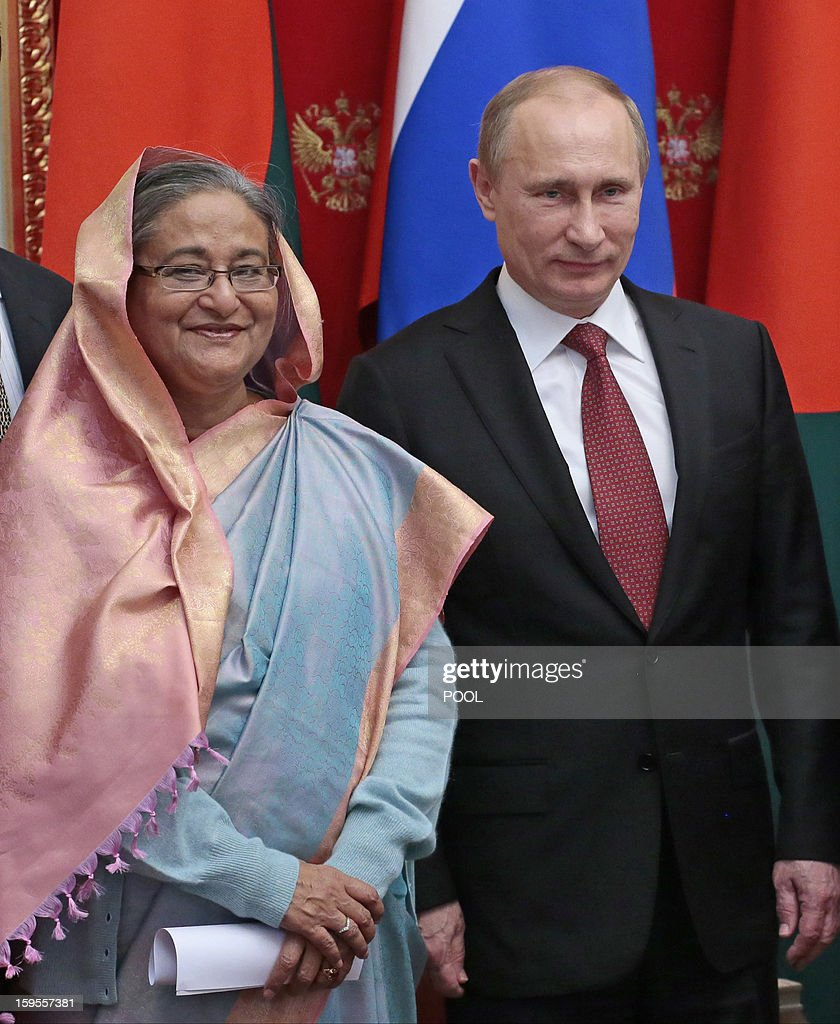 Russia's President Vladimir Putin (R) and Bangladesh's Prime Minister Sheikh Hasina attend a signing ceremony as they meet in Moscow, on January 15, 2013. Putin met yesterday Bangladesh's Prime Minister for talks and for the signature of the impoverished Asian nation's largest defence contract since its independence in 1971. AFP PHOTO/ POOL/ MIKHAIL METZEL