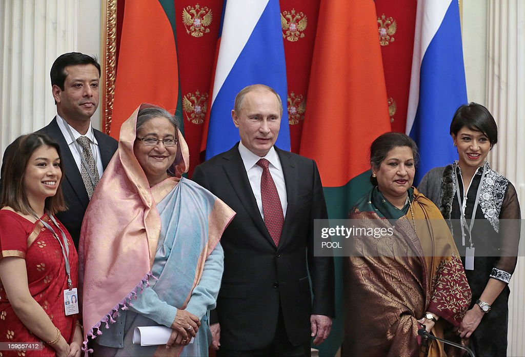 Russia's President Vladimir Putin (3rd R) and Bangladesh's Prime Minister Sheikh Hasina (3rd L) attend a signing ceremony as they meet in Moscow, on January 15, 2013. Putin met yesterday Bangladesh's Prime Minister for talks and for the signature of the impoverished Asian nation's largest defence contract since its independence in 1971.