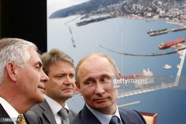 Russia's President Vladimir Putin and ExxonMobil Chairman and CEO Rex Tillerson attend at the ceremony of the signing of an agreement between...