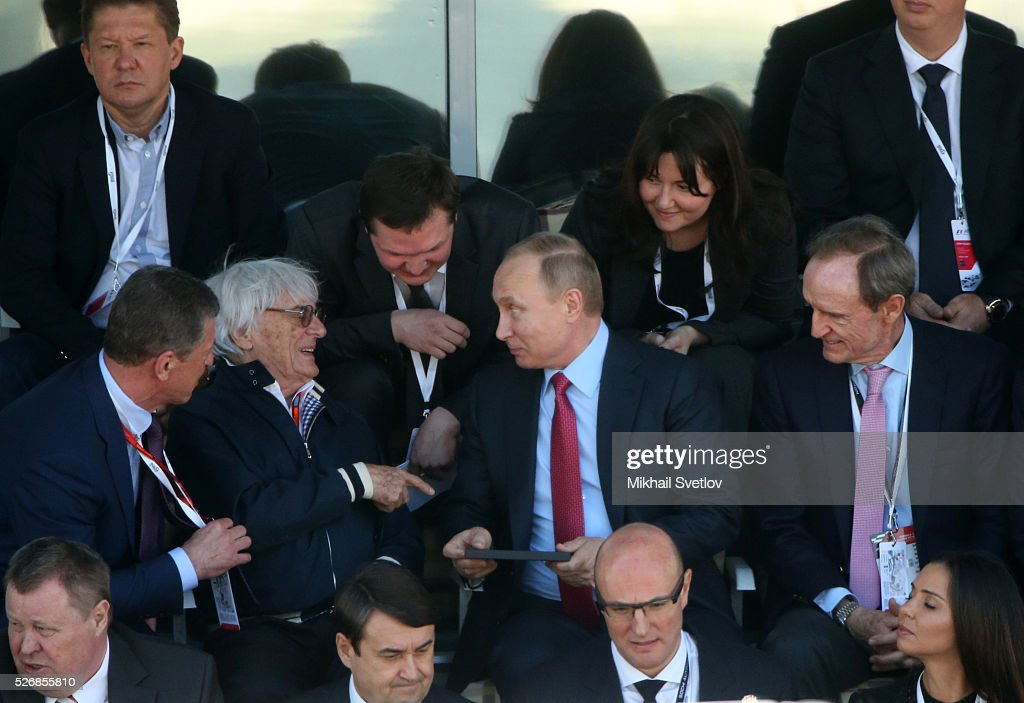 Russia's President Vladimir Putin (C) and Formula 1 Executive Bernie Ecclestone (L) are seen during the Formula One Russian Grand Prix at the Sochi Autodrom racetrack on May 1, 2016 in Sochi, Russia.