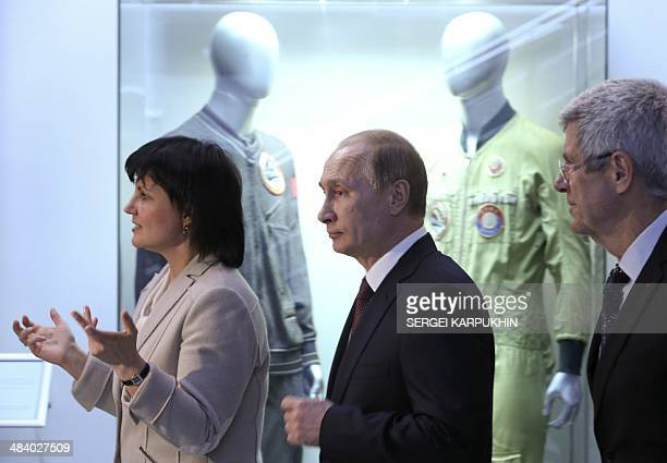 Russia's President Vladimir Putin and Giovanni Bignami president of the Committee on Space Research listen to explanations during their visit to the...