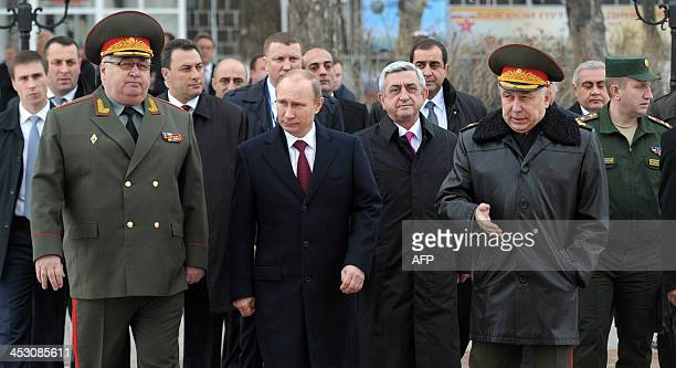 Russia's President Vladimir Putin and his Armenian counterpart Serzh Sarksian visit the Russian military base in the Armenian city of Gyumri on...