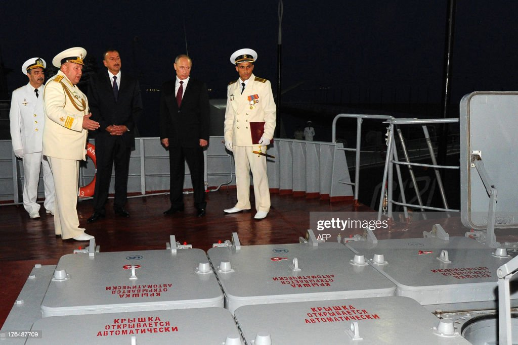 Russia's President Vladimir Putin (2nd R) and his Azerbaijani counterpart Ilham Aliyev (3rd L) visit the Russian Navy Caspian Flotilla's Dagestan missile ship anchored in Baku, on August 13, 2013. Russian crude giant Rosneft signed yesterday an oil and gas agreement with Azerbaijan's state energy firm aimed at loosening the European Union's ties with the key Caspian market. Neither side disclosed the full details of a deal that was sealed on the sidelines of talks in Baku between visiting Putin and Aliyev.