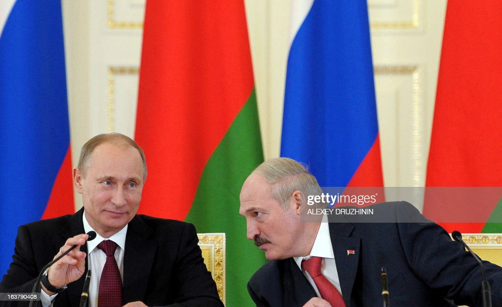 Russia's President Vladimir Putin (L) and his Belarus counterpart Alexander Lukashenko attend their joint press conference at the Konstantinovsky palace in Strelna just outside St.Petersburg, on March 15, 2013, after a meeting of the Russia-Belarus Union State's Supreme State Council .