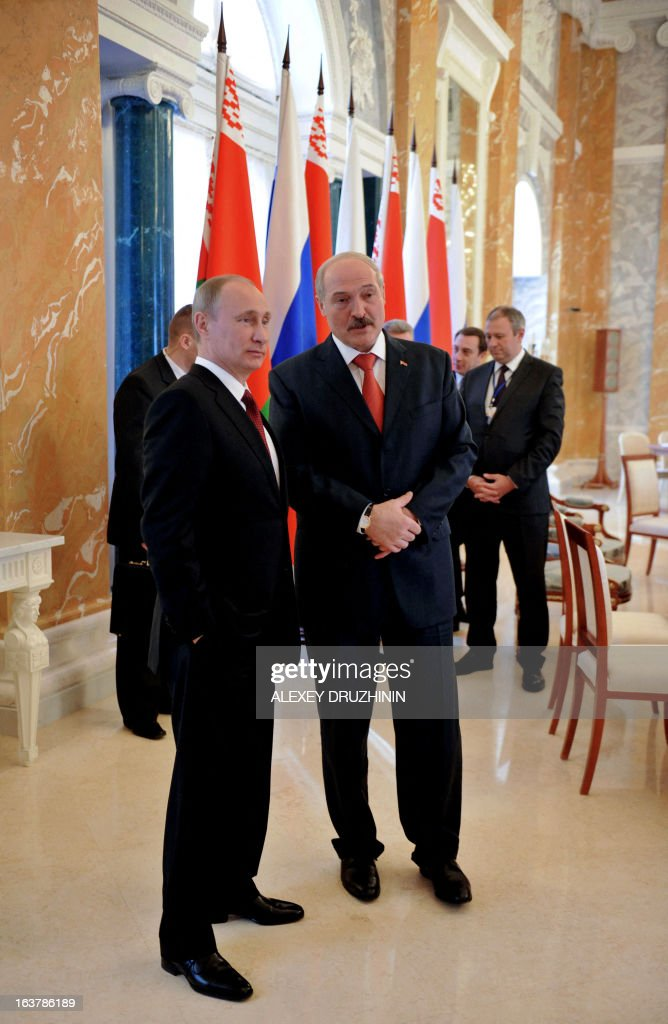 Russia's President Vladimir Putin (L) and his Belarus counterpart Alexander Lukashenko (R) speka at the Konstantinovsky palace in Strelna just outside St.Petersburg, on March 15, 2013, after a meeting of the Russia-Belarus Union State's Supreme State Council .