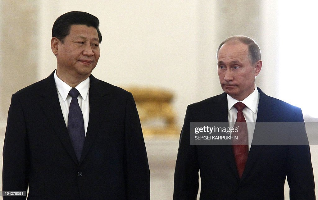 Russia's President Vladimir Putin (R) and his Chinese counterpart Xi Jinping meet in the Grand Kremlin Palace in Moscow, on March 22, 2013. Xi Jinping arrived today in Moscow on his first foreign trip, to cement ties between the two countries by inking a raft of energy and investment accords. AFP PHOTO / POOL/ SERGEI KARPUKHIN
