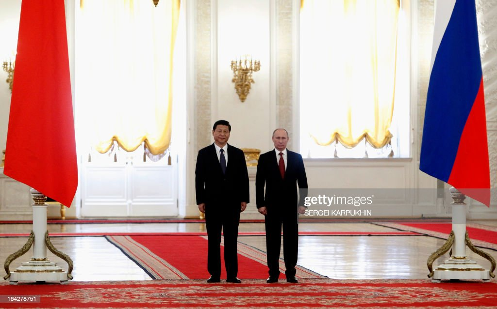 Russia's President Vladimir Putin (R) and his Chinese counterpart Xi Jinping meet in the Grand Kremlin Palace in Moscow, on March 22, 2013. Xi Jinping arrived today in Moscow on his first foreign trip, to cement ties between the two countries by inking a raft of energy and investment accords.