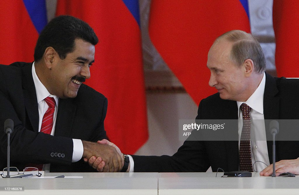 Russia's President Vladimir Putin (R) and his Venezuelan counterpart Nicolas Maduro shakes hands during a signing ceremony at the Kremlin in Moscow, on July 2, 2013. Fugitive US intelligence leaker Edward Snowden was denied asylum by a host of countries today after applying for a safe haven in 21 nations spanning the globe in hopes of winning protection from American justice. Snowden found particular support in Maduro .But Maduro refused to entertain speculation he might take Snowden on a plane with him from Moscow -- a possibility raised both by Russian media and political observers of the explosive case. AFP PHOTO / POOL/ MAXIM SHEMETOV