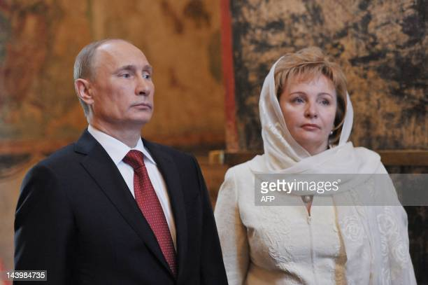Russia's President Vladimir Putin and his wife Lyudmila attend a service at Blagoveshchensky cathedral in Moscow's Kremlin on May 7 after Putin's...