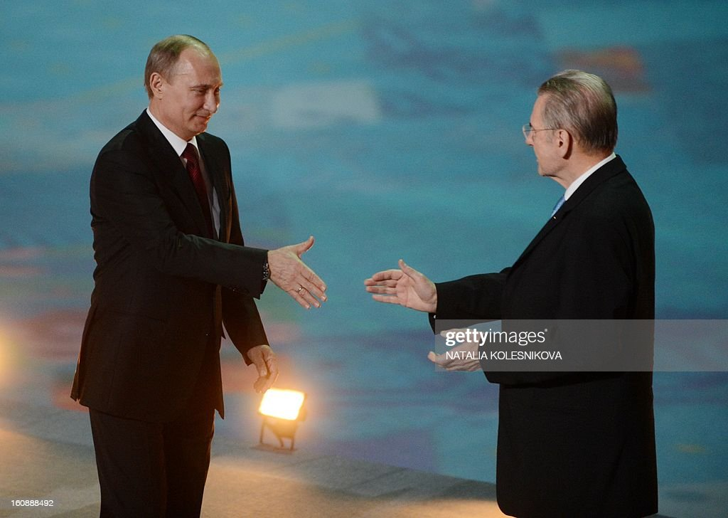 Russia's President Vladimir Putin (L) and IOC President Jacques Rogge shake hands as they take part in a ceremony celebrating the one year countdown to the Sochi 2014 Winter Olympics opening at the Bolshoi Ice Dome rink in the Black Sea city of Sochi, on February 7, 2013. Putin vowed today Russia would justify expectations when it hosts the Winter Olympic Games in Sochi in one year, after ruthlessly firing an official blamed for delays in building infrastructure.