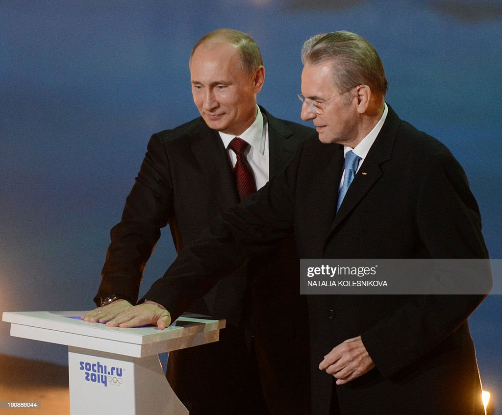 Russia's President Vladimir Putin (L) and IOC President Jacques Rogge take part in a ceremony celebrating the one year countdown to the Sochi 2014 Winter Olympics opening at the Bolshoi Ice Dome rink in the Black Sea city of Sochi, on February 7, 2013. Putin vowed today Russia would justify expectations when it hosts the Winter Olympic Games in Sochi in one year, after ruthlessly firing an official blamed for delays in building infrastructure.