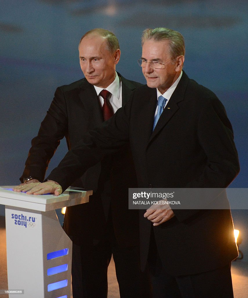 Russia's President Vladimir Putin (L) and IOC President Jacques Rogge take part in a ceremony celebrating the one year countdown to the Sochi 2014 Winter Olympics opening at the Bolshoi Ice Dome rink in the Black Sea city of Sochi, on February 7, 2013. Putin vowed today Russia would justify expectations when it hosts the Winter Olympic Games in Sochi in one year, after ruthlessly firing an official blamed for delays in building infrastructure. AFP PHOTO / NATALIA KOLESNIKOVA