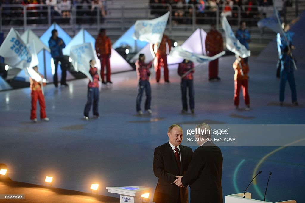 Russia's President Vladimir Putin (front L) and IOC President Jacques Rogge (front R) take part in a ceremony celebrating the one year countdown to the Sochi 2014 Winter Olympics opening at the Bolshoi Ice Dome rink in the Black Sea city of Sochi, on February 7, 2013. Putin vowed today Russia would justify expectations when it hosts the Winter Olympic Games in Sochi in one year, after ruthlessly firing an official blamed for delays in building infrastructure.