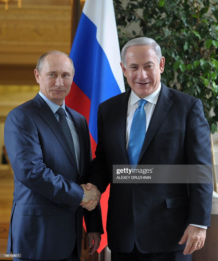 Russia's President Vladimir Putin and Israeli Prime Minister Benjamin Netanyahu shake hands during their meeting at Putin's residence in the Black Sea resort of Sochi, on May 14, 2013. Putin and Netanyahu began talks today on the conflict in Syria amid growing concern about Moscow's continuing arms deliveries to the Damascus regime and a spiralling death toll.