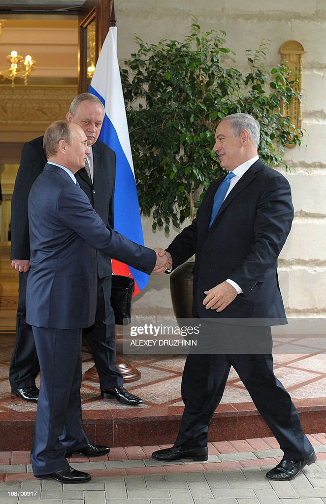 Russia's President Vladimir Putin (L) and Israeli Prime Minister Benjamin Netanyahu shake hands during their meeting at Putin's residence in the Black Sea resort of Sochi, on May 14, 2013. Putin and Netanyahu began talks today on the conflict in Syria amid growing concern about Moscow's continuing arms deliveries to the Damascus regime and a spiralling death toll.