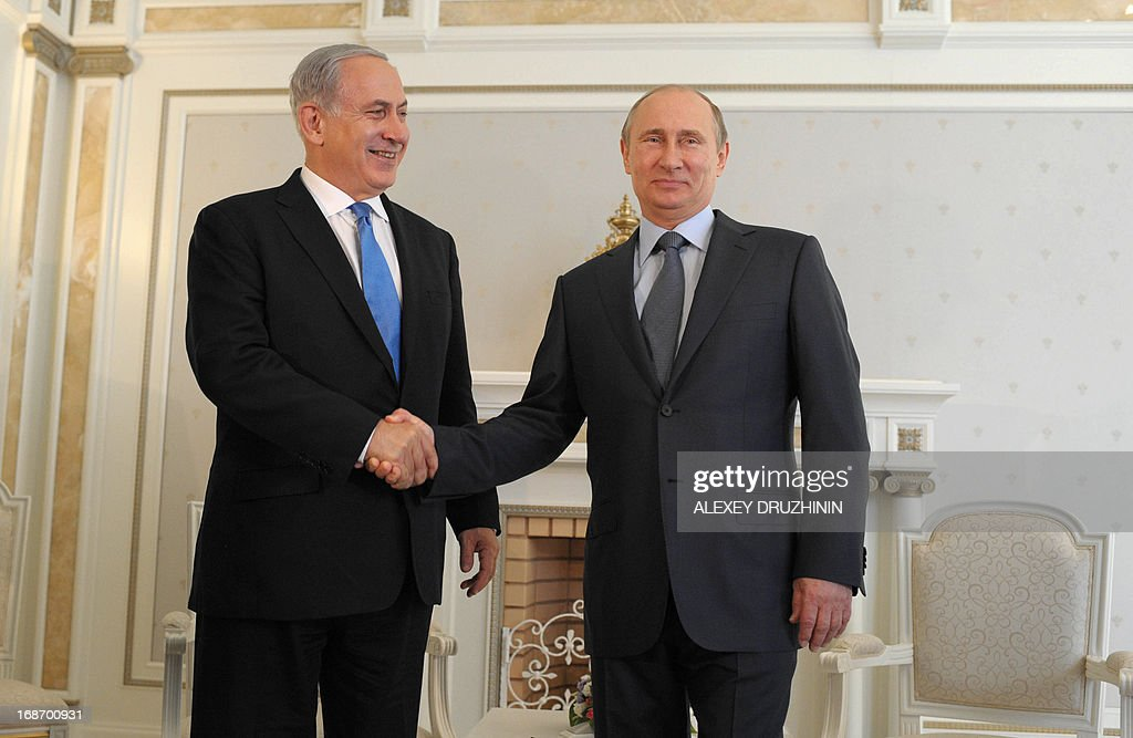 Russia's President Vladimir Putin (R) and Israeli Prime Minister Benjamin Netanyahu shake hands during their meeting at Putin's residence in the Black Sea resort of Sochi, on May 14, 2013. Putin and Netanyahu began talks today on the conflict in Syria amid growing concern about Moscow's continuing arms deliveries to the Damascus regime and a spiralling death toll.