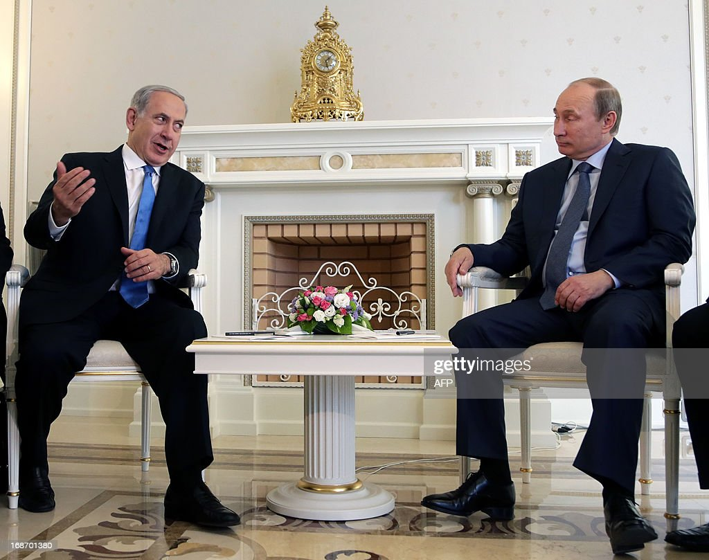 Russia's President Vladimir Putin (R) and Israeli Prime Minister Benjamin Netanyahu speak during their meeting at Putin's residence in the Black Sea resort of Sochi, on May 14, 2013. Putin and Netanyahu began talks today on the conflict in Syria amid growing concern about Moscow's continuing arms deliveries to the Damascus regime and a spiralling death toll.