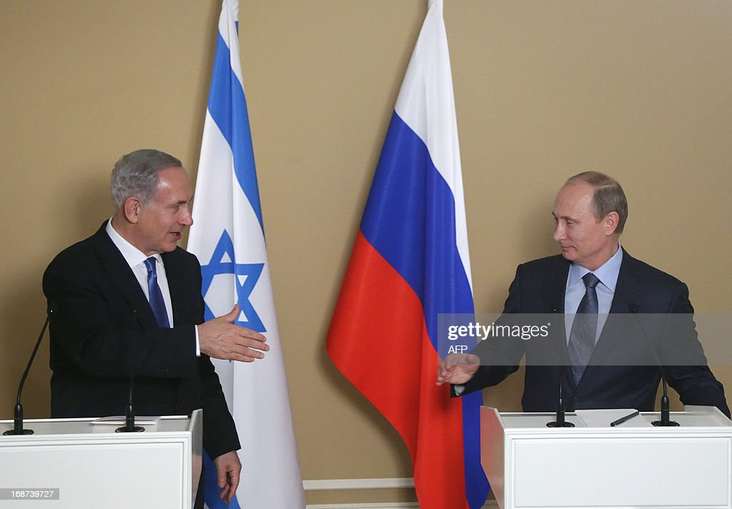 Russia's President Vladimir Putin (R) and Israeli Prime Minister Benjamin Netanyahu attend a joint press conference after their meeting at Putin's residence in the Black Sea resort of Sochi, on May 14, 2013. Putin warned today against any moves that would further destabilise the situation in Syria, speaking after talks with the visiting Israeli Prime Minister. AFP PHOTO/ POOL/ MAXIM SHIPENKOV