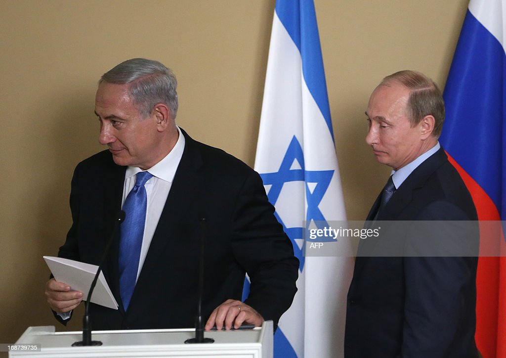 Russia's President Vladimir Putin (R) and Israeli Prime Minister Benjamin Netanyahu attend a joint press conference after their meeting at Putin's residence in the Black Sea resort of Sochi, on May 14, 2013. Putin warned today against any moves that would further destabilise the situation in Syria, speaking after talks with the visiting Israeli Prime Minister.