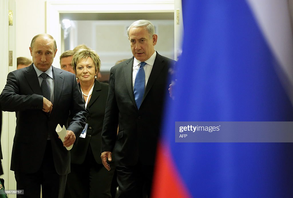 Russia's President Vladimir Putin(L) and Israeli Prime Minister Benjamin Netanyahu (R) arrive for a joint press conference after their meeting at Putin's residence in the Black Sea resort of Sochi, on May 14, 2013. Putin warned today against any moves that would further destabilise the situation in Syria, speaking after talks with the visiting Israeli Prime Minister.
