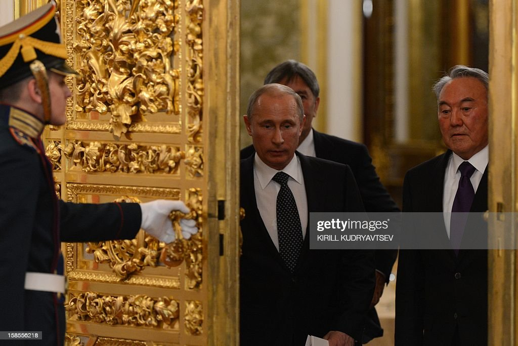 Russia's President Vladimir Putin (C) and Kazakhstan President Nursultan Nazarbayev (R), enter a hall during a meeting of the ex-Soviet nations leaders in the Kremlin in Moscow, on December 19, 2012. Russia sought today to expand its sway over ex-Soviet nations as it hosted economic integration talks Washington has painted as an attempt by Moscow to 're-Sovietise' the region. AFP PHOTO / POOL / KIRILL KUDRYAVTSEV
