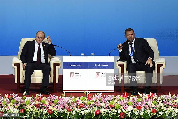Russia's President Vladimir Putin and Oleg Deripaska CEO of UC Rusal attend the APEC CEO Summit as part of the AsiaPacific Economic Cooperation...