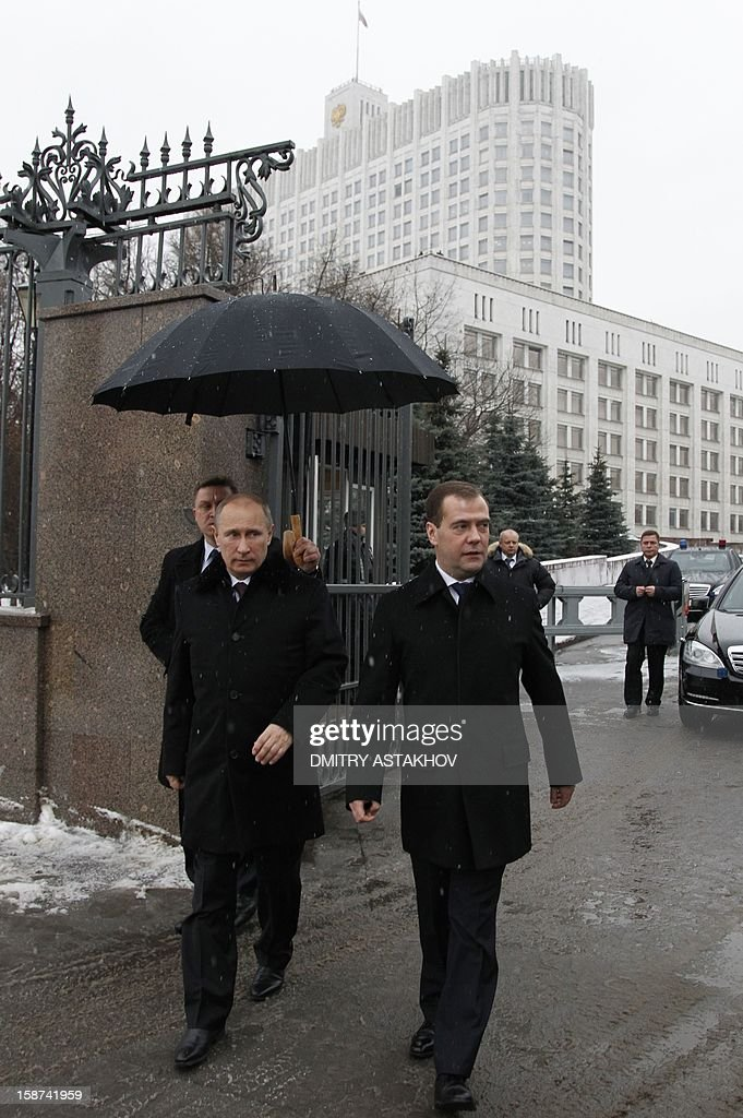 Russia's President Vladimir Putin (L) and Prime Minister Dmitry Medvedev arrive for the unveiling ceremony for the monument to Pyotr Stolypin, Russia's prime minister from 1906 to 1911, just at the government headquarters in Moscow , on December 27, 2012. Putin told today a meeting of top officials in the Kremlin he intended to sign into law a bill banning Americans from adopting Russian children that has raised tensions between Moscow and Washington.