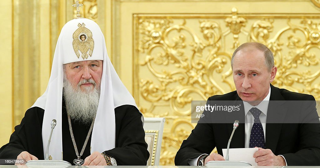Russia's President Vladimir Putin and Russian Orthodox Patriarch Kirill attend a meeting of top clergy of the Russian Orthodox Church in the Kremlin in Moscow, on February 1, 2013.