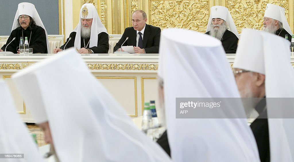 Russia's President Vladimir Putin (back C) and Russian Orthodox Patriarch Kirill (back 2nd L) attend a meeting of top clergy of the Russian Orthodox Church in the Kremlin in Moscow, on February 1, 2013.