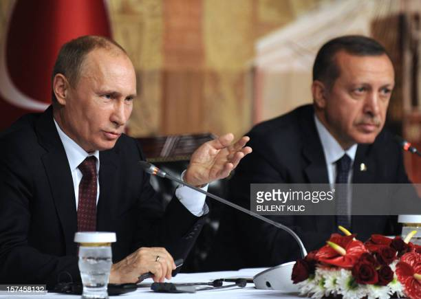 Russia's president Vladimir Putin and Turkish Prime minister Recep Tayyip Erdogan give a press conference after a meeting in Istanbul on December 3...