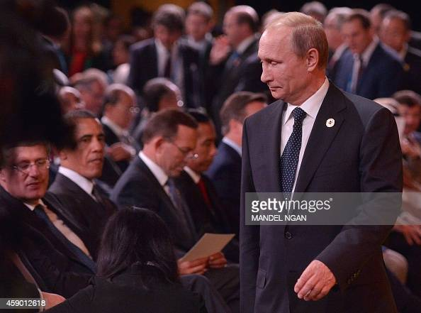 Russia's President Vladimir Putin arrives as Canada's Prime Minister Stephen Harper and US President Barack Obama look on during the G20 Summit...
