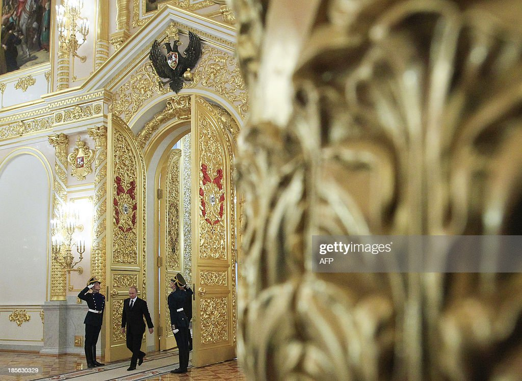 Russia's President Vladimir Putin (2nd R) arrives for a ceremony to hand over the diplomatic credentials at the Kremlin in Moscow, on October 23, 2013. The year 2013 was officially supposed to be one of cultural exchange to highlight the friendship between Russia and the Netherlands whose friendship dates back to the 1697 Peter the Great's visit. But lately, the relations between Russia and the Netherlands have deteriorated over last month Moscow's arrest of the 30-member crew of a Dutch-flagged Greenpeace ship, the brief detention of a Russian diplomat in the Netherlands, the assault on a senior Dutch diplomat in his Moscow apartment and the Russian embassy flat break-in at The Hague.