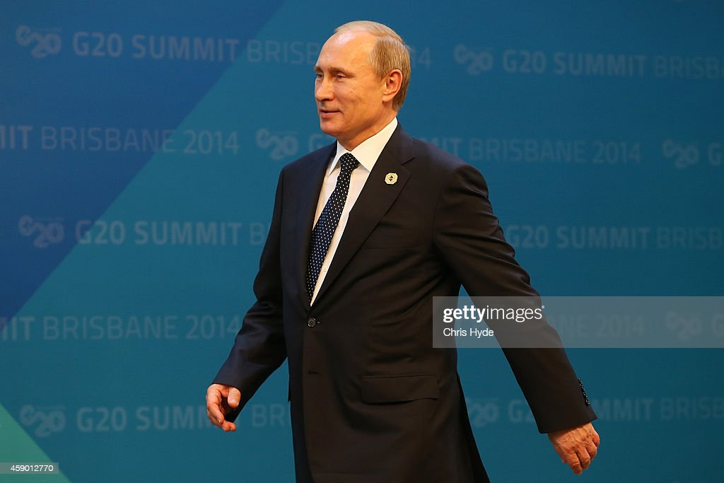 Russia's President Vladimir Putin arrives for the official welcome at the Brisbane Convention and Exhibitions Centre on November 15 2014 in Brisbane...